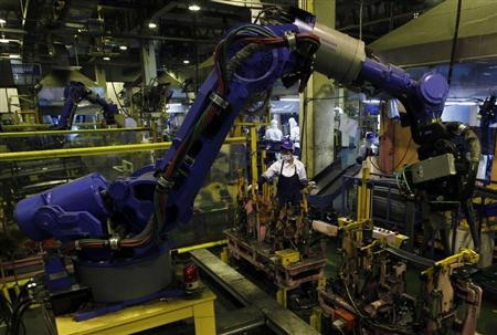 Employees work in an automobile spare parts factory in Africa
