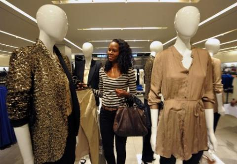 A woman looks at clothing displayed at the newly opened store of Africa