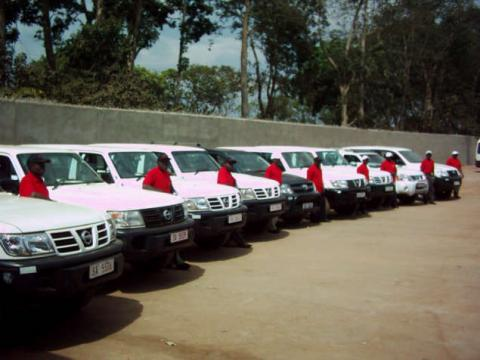 Staff and luxury 4x4 rental cars in Africa